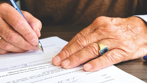 elderly man signing will capacity issues estate planning administration lawyers